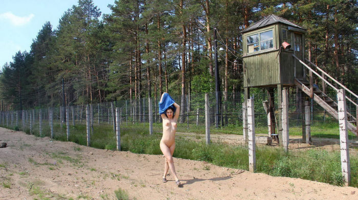 Naked girl walks at a military facility
