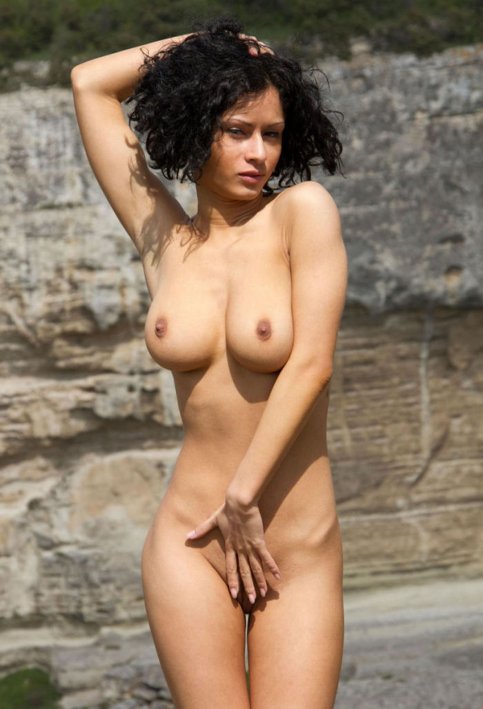 Luxury curly brunette with big soft boobs in the mountains