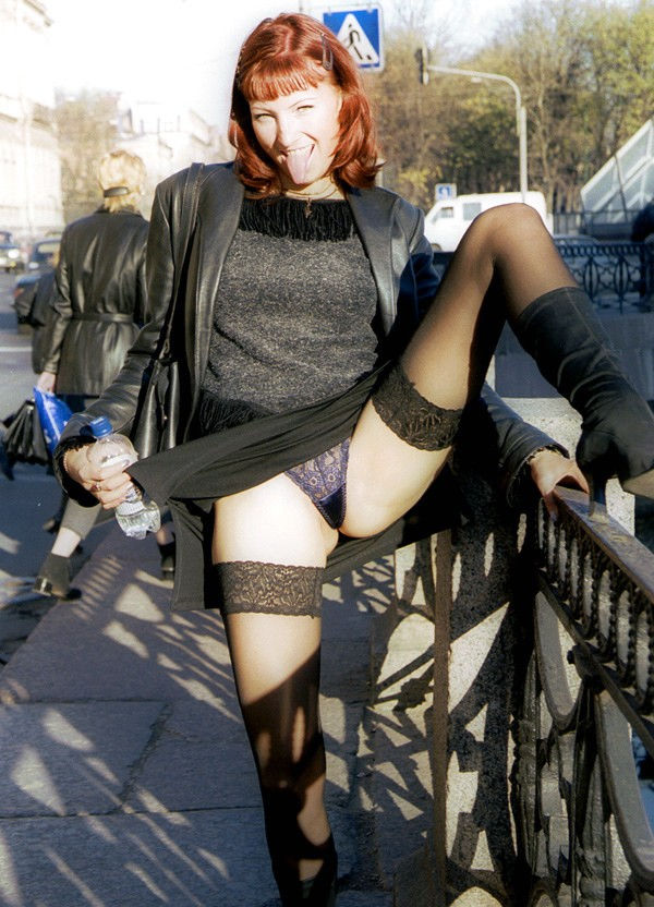 Retro photos of redhead girl who loves to flash in public