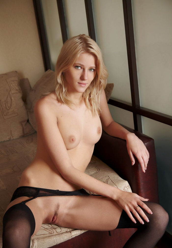 Stunning blonde Mila I in stockings closely shows her pretty vulva