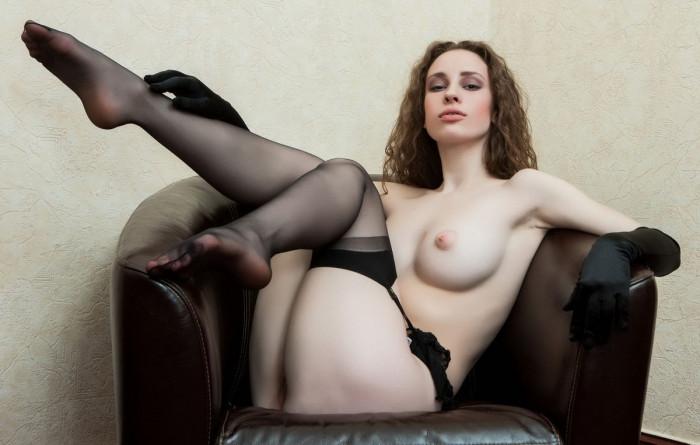 sweet busty babe posing in black stockings 11 photos