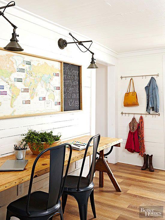 Such a cool desk area - wood slab desk with vintage legs, swing arm sconces, vintage map: