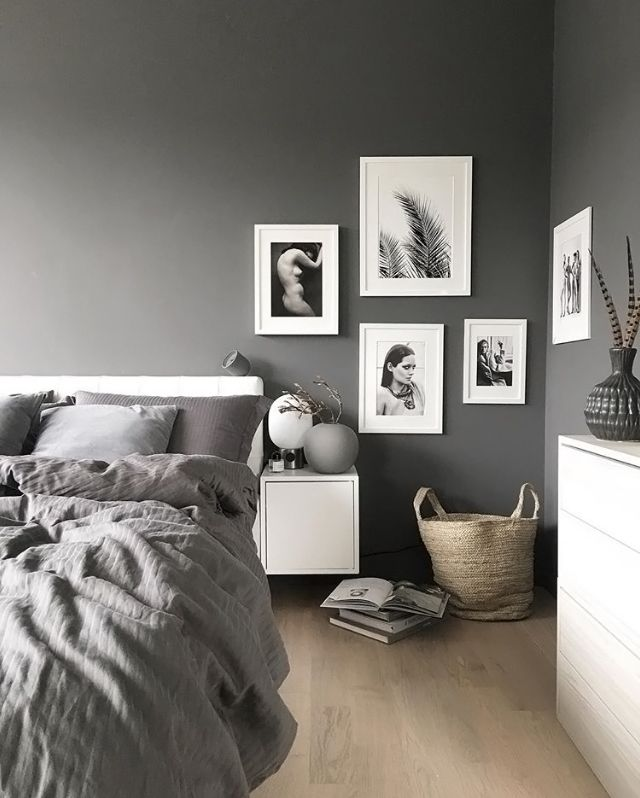 a grey and white bedroom is to me bed black furniture