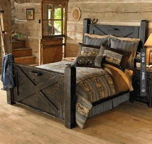 like this black distressed barn door bed check out more master bedroom ideas at repurposed bedroom furniture