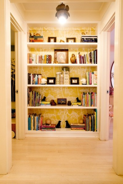A built-in bookcase with wallpapered back. I'm a complete ...