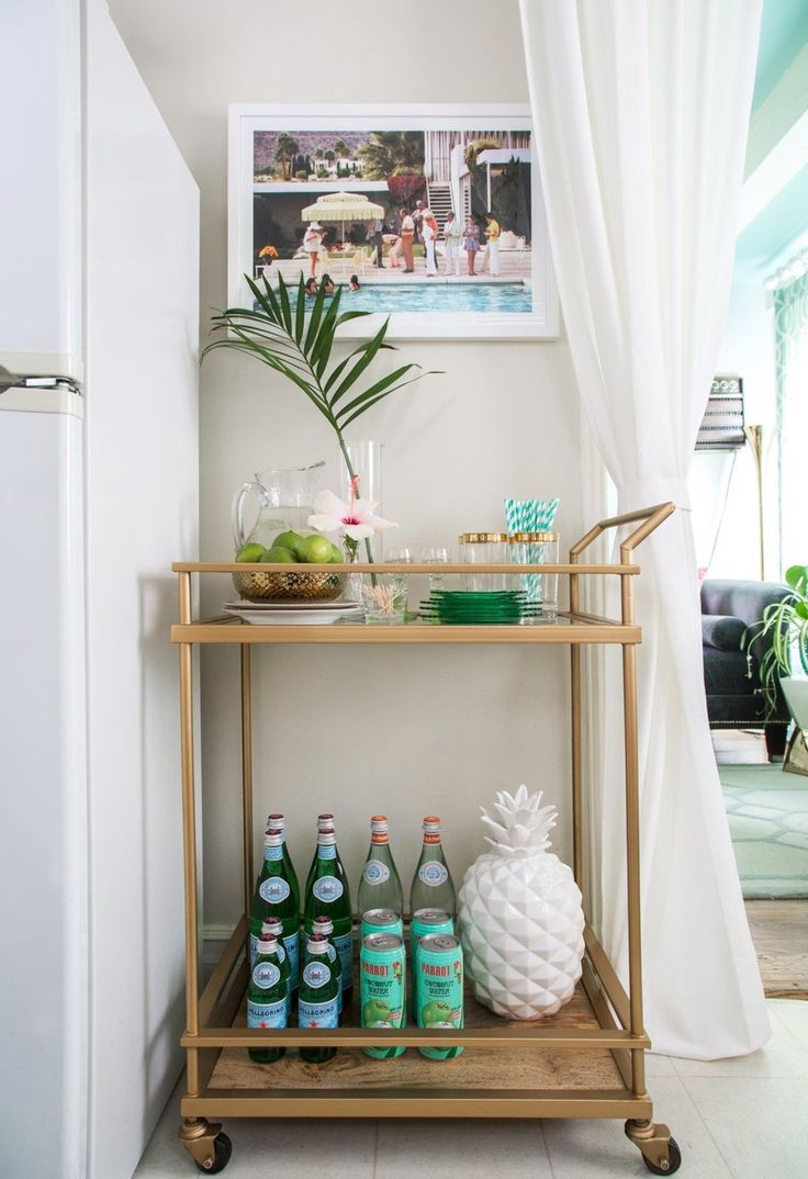 beach apartment decor beachy kitchen table House Tour Colorful Palm Beach Regency Style Home Apartment Therapy