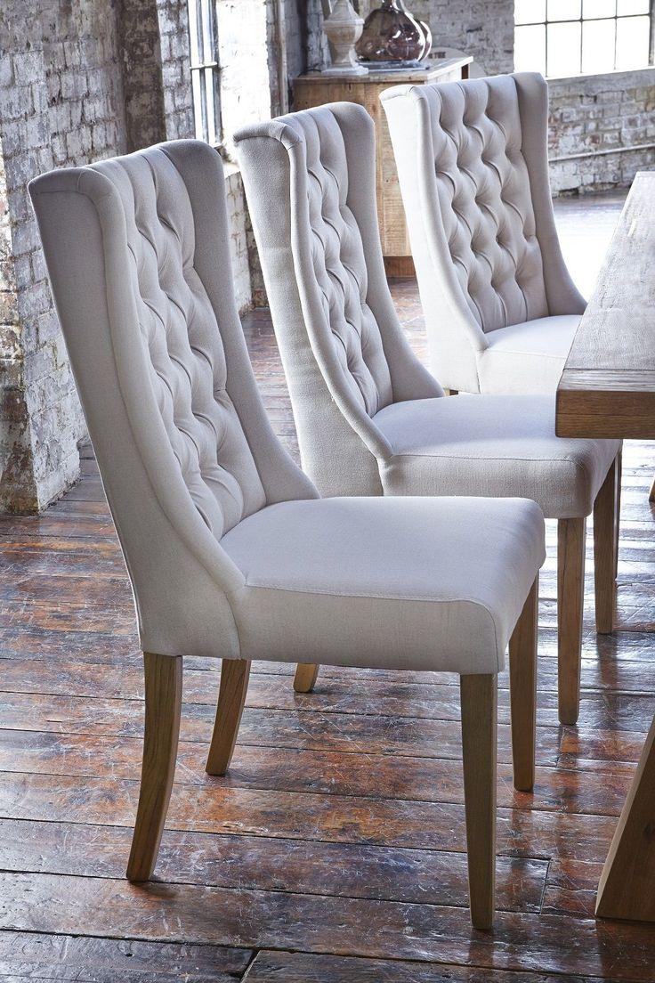 upholstered dining room chairs teal kitchen chairs Upholstered winged chairs will give your dining room an air of elegance We love