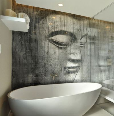Buddha wallpaper in a bathroom. It's sealed behind a glass panel, and has a special texture ...