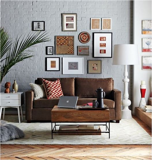 this image is another example of how to decorate around a dark sofa even if gray wallsred grey walls brown furniture i
