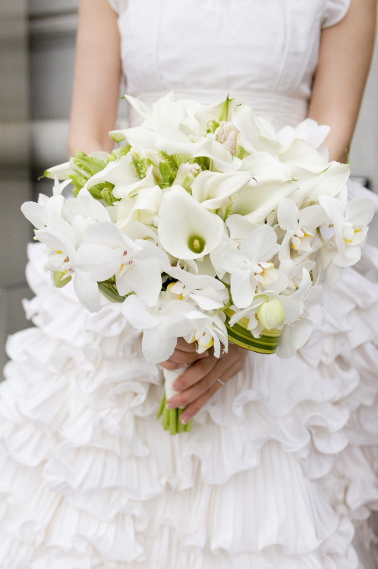 white wedding bouquets all white wedding dress All white bouquet with a touch of green