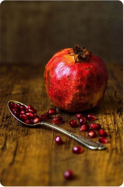 still life photography | Pomegranate fruit and spoon on ...