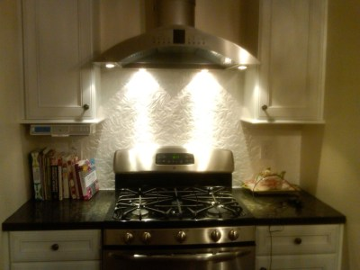 Wallpaper Backsplash - use Anaglypta textured wallpaper & paint with several coats of high gloss ...