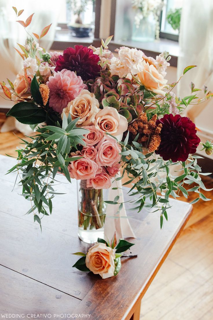fall flower arrangements fall flowers for weddings Creativo Loft wedding fall bouquet beautiful cascading bouquet in coral burgundy peach ivory by Toni Lenzi at Simply Flowers Chicago