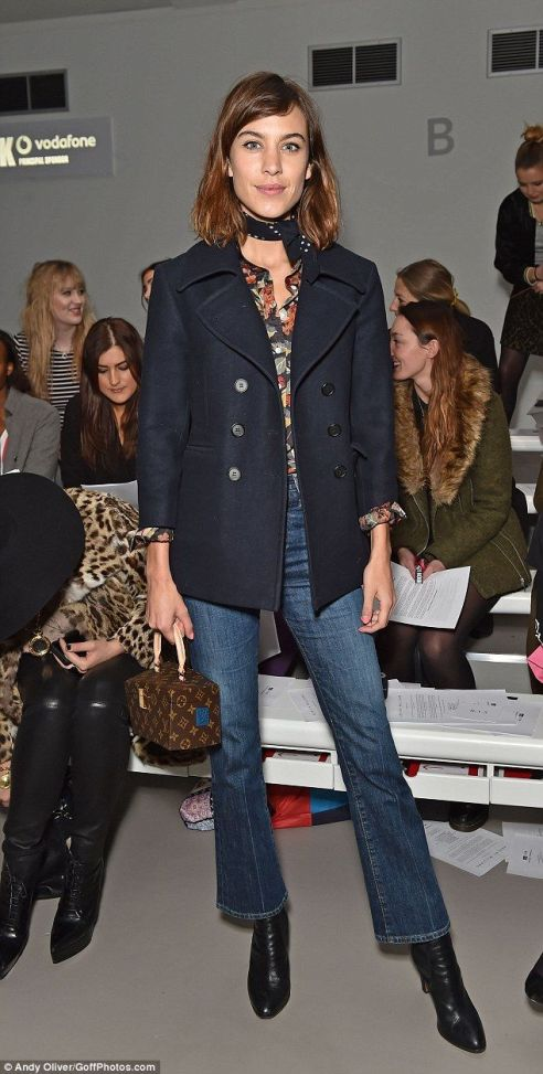 Chic: Presenter Alexa opted for bootcut jeans and a navy coat as she attended her first sh...: