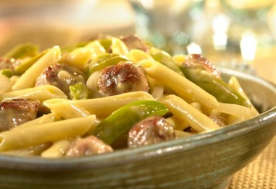 This simple skillet dish combines mac and cheese with sausage and peppers to make a family ...
