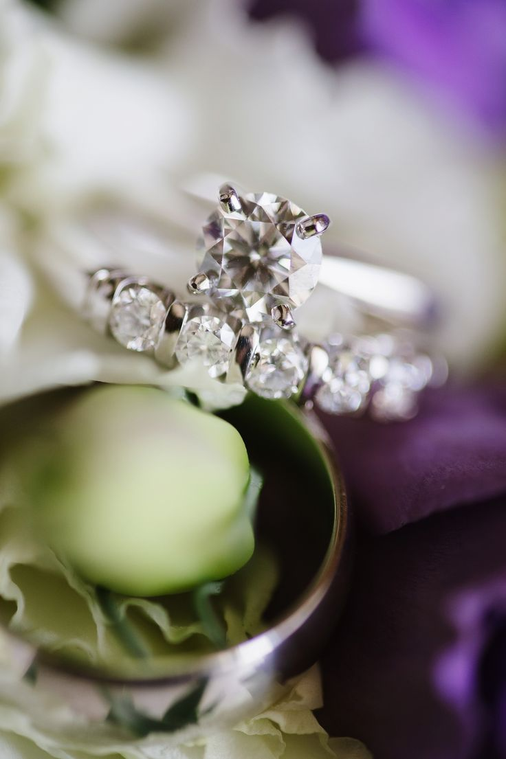 engagement rings military wedding rings Classic Solitaire Engagement Ring with gorgeous diamond band on wedding bouquet Natalie Franke Photography