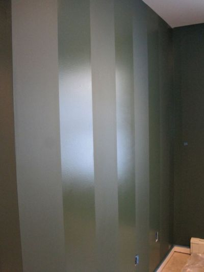 paint a wall in flat paint, then paint stripes in same color but semi-gloss for a lovely effect ...