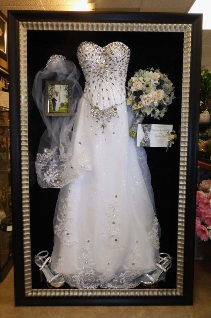 wedding dress preservation wedding dress storage All of it framed shoes dress veil flowers invitation