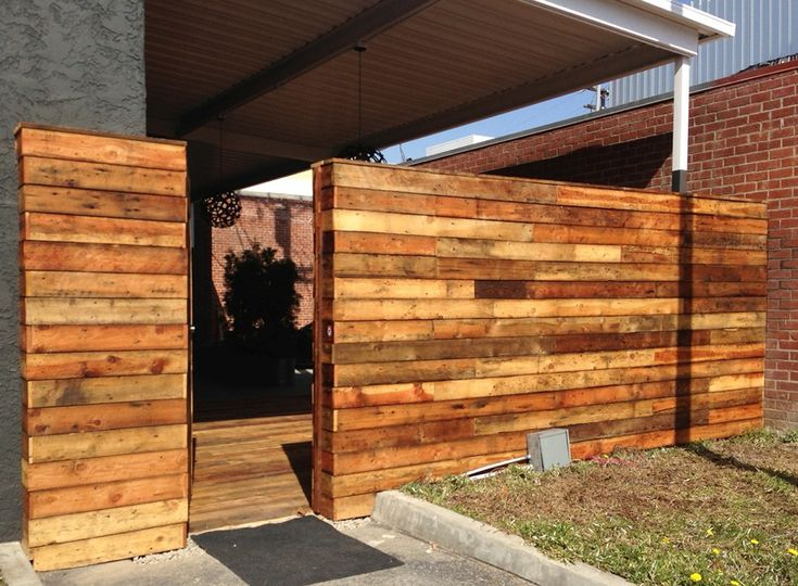 original circle sawn softwoods were applied to the exterior entry of an architecture firm in san office e