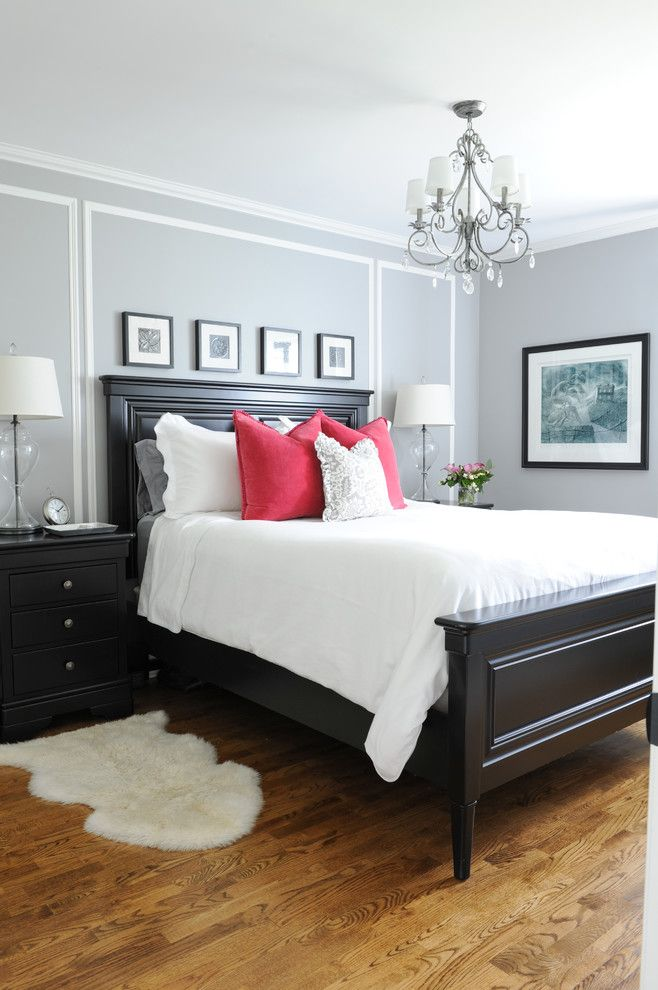 master bedroom with his and hers nightstands gray walls white bedding red accent bed black furniture e