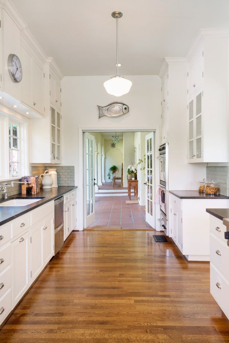 spanish colonial kitchen kitchen cabinets in spanish California Spanish Revival kitchen sensitive remodel features soapstone counters subway tiles bespoke