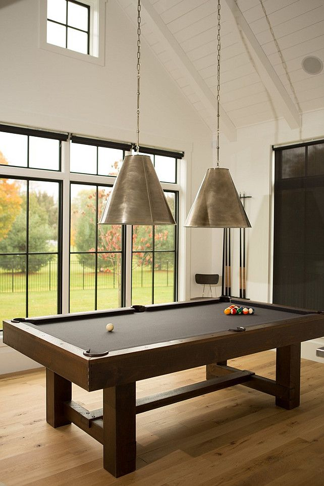 game room lighting features a paneled cathedral ceiling lined with two goodman hanging gameroom g
