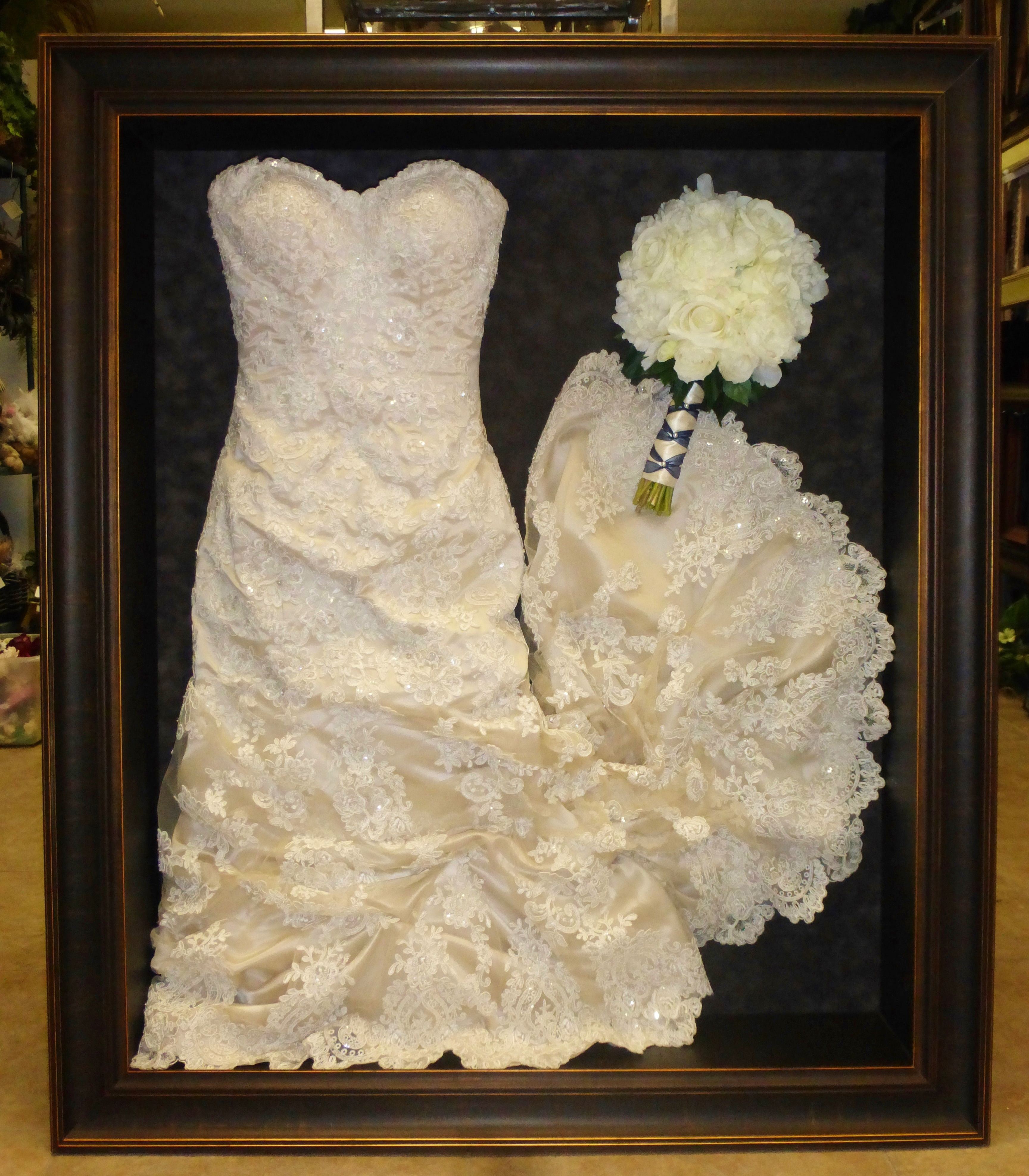 wedding dress storage Framed wedding dress and bouquet framed by Floral Keepsakes This dress has been gathered up