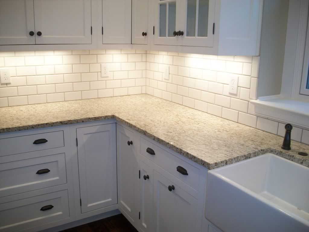 kitchen colors and tile kitchen subway tile backsplash giallo ornamental granite with biscuit subway tile backsplash Google Search