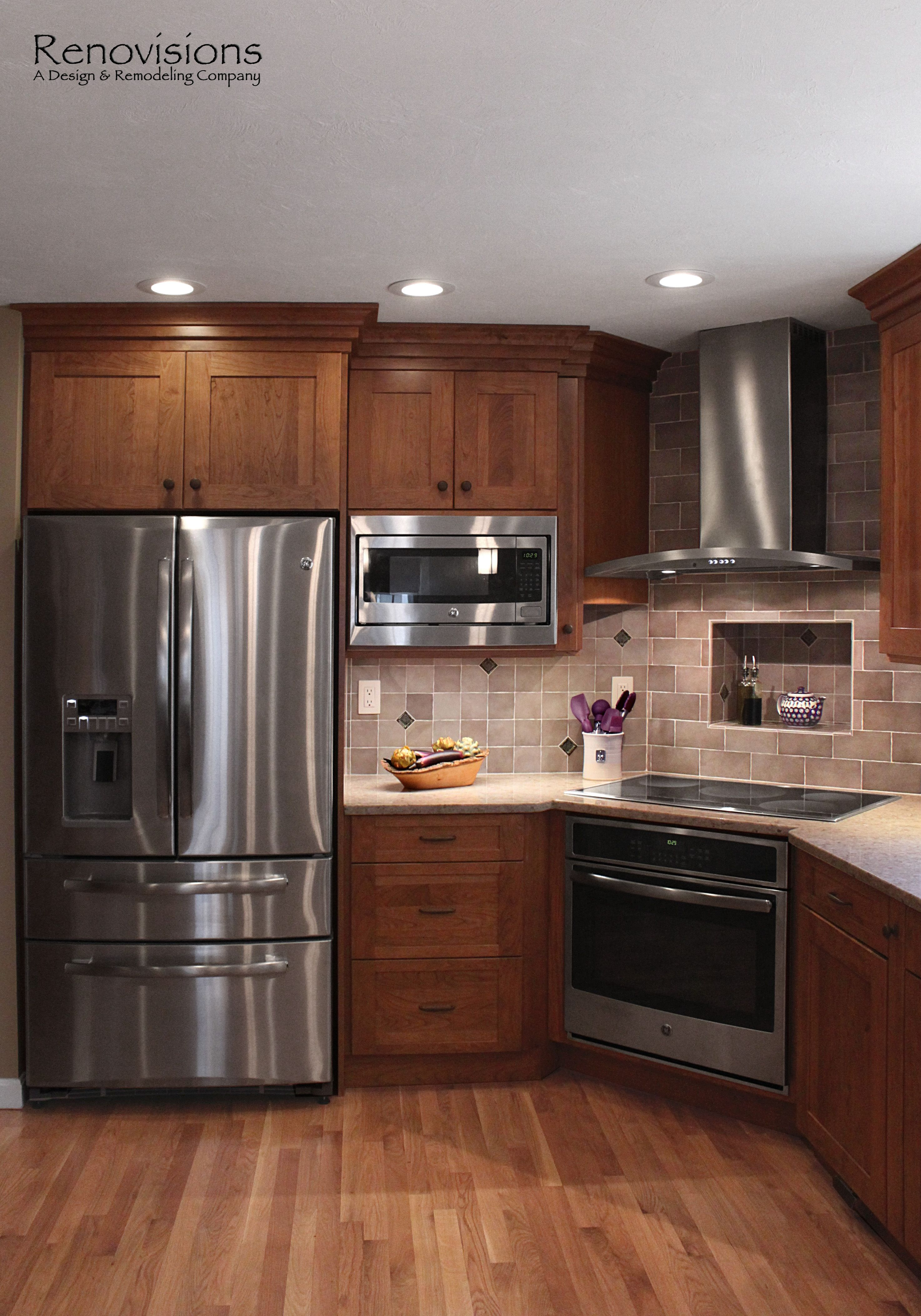 kitchen remodel app Kitchen remodel by Renovisions Induction cooktop stainless steel appliances cherry cabinets shaker