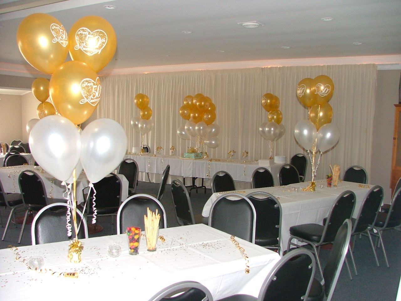 party ideas 50th anniversary 50th wedding anniversary 50th Anniversary Table Decorations with the rolo s in a vase