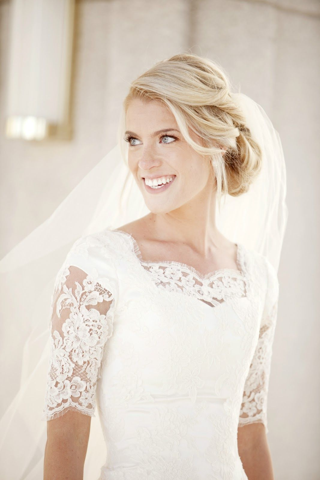 modest wedding dress Alta Moda bride Kate in a modest lace wedding dress with elbow sleeves Image by