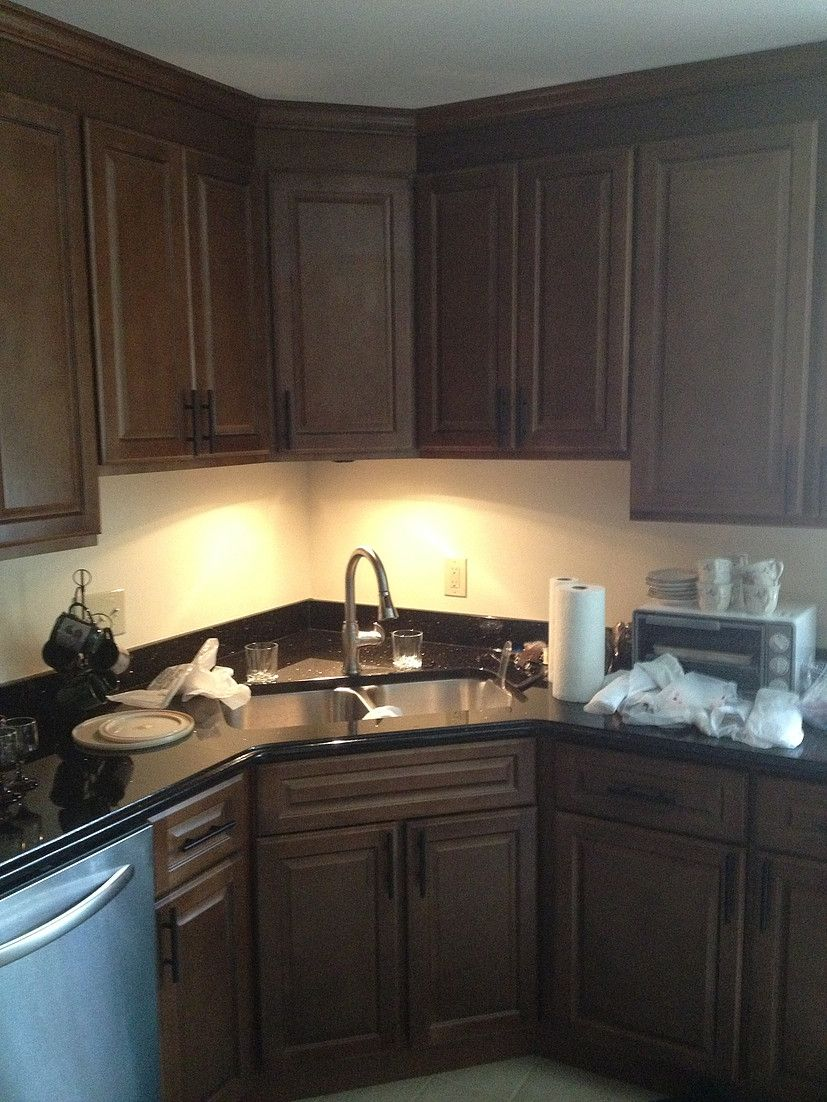 corner kitchen sinks Two Poor Teachers Kitchen remodel corner sink stainless steel dishwasher cabinets under