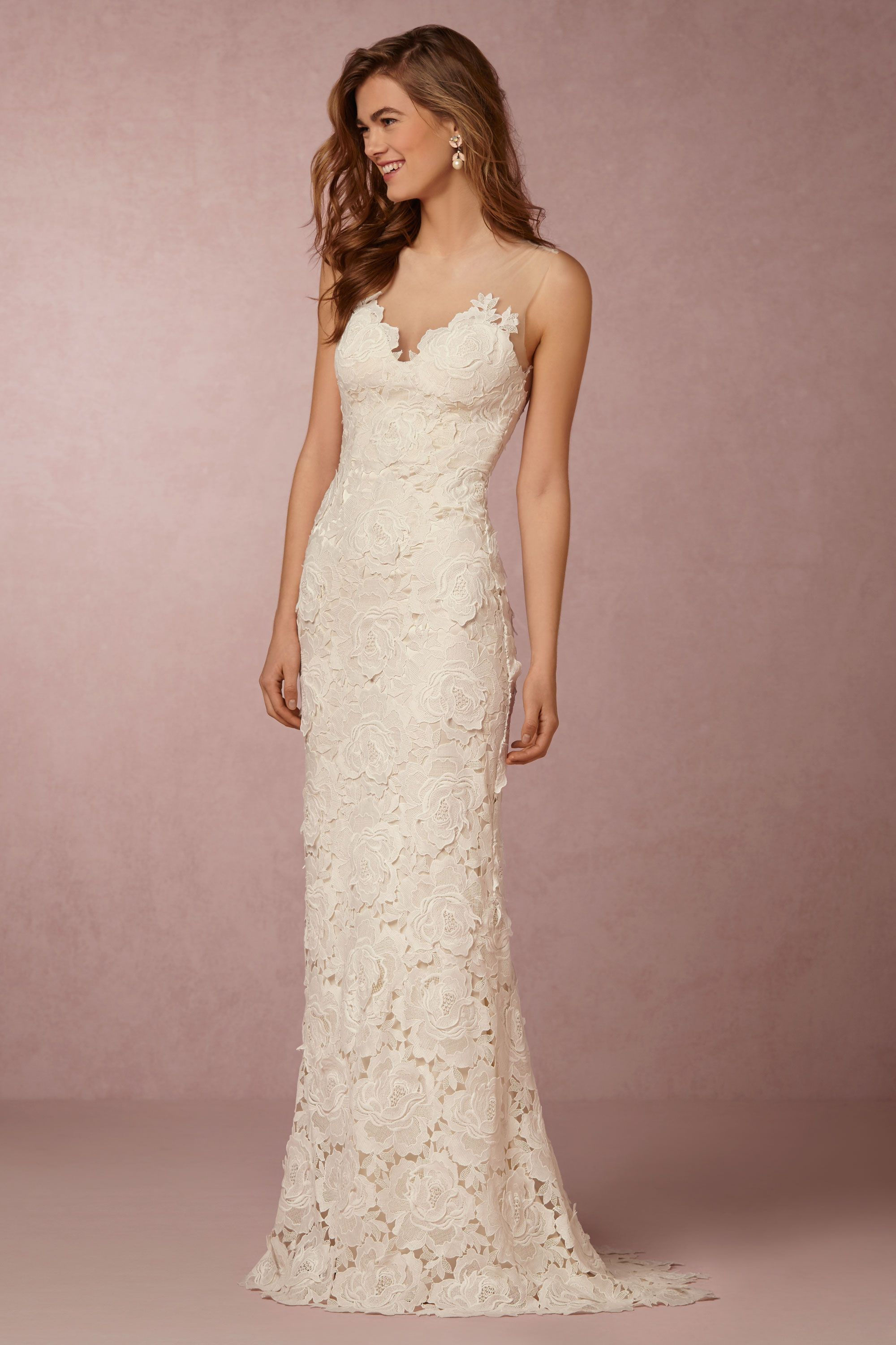 simple vintage wedding dresses Lace wedding dress with a bold floral motif The figure hugging silhouette and illusion neckline