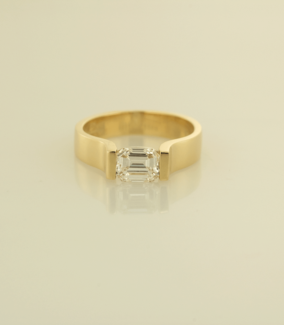 wedding ring designers 18KT yellow gold contemporary solitaire engagement ring with a 98ct emerald cut diamond