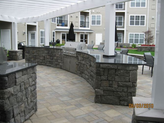outdoor kitchen cabinets Kitchens Curved Radius with pergoal posts built right through modular cabinets