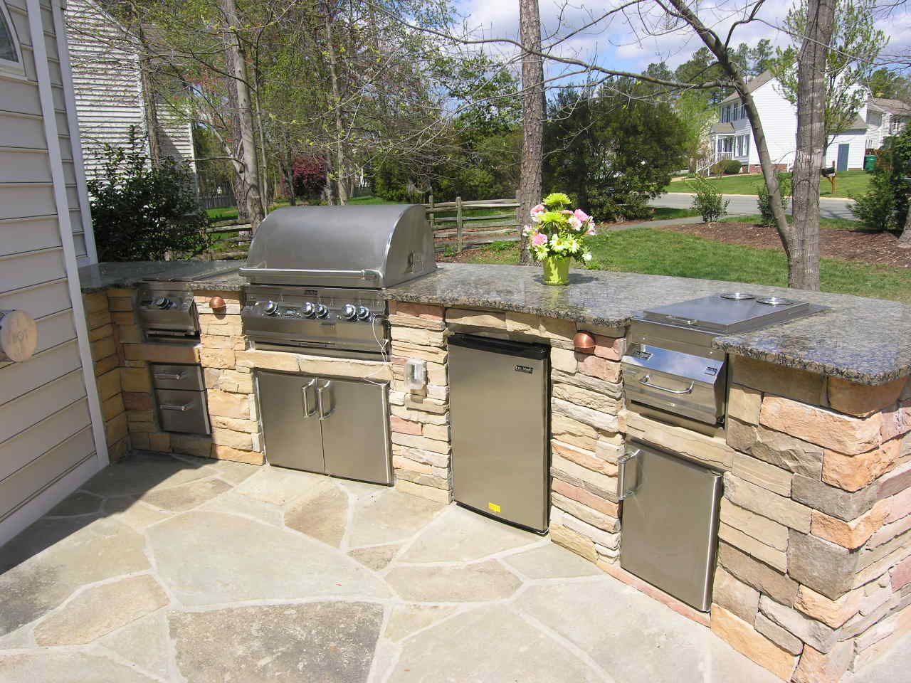 outdoor kitchen design backyard patio with kitchen ideas This custom outdoor kitchen design has space for several outdoor