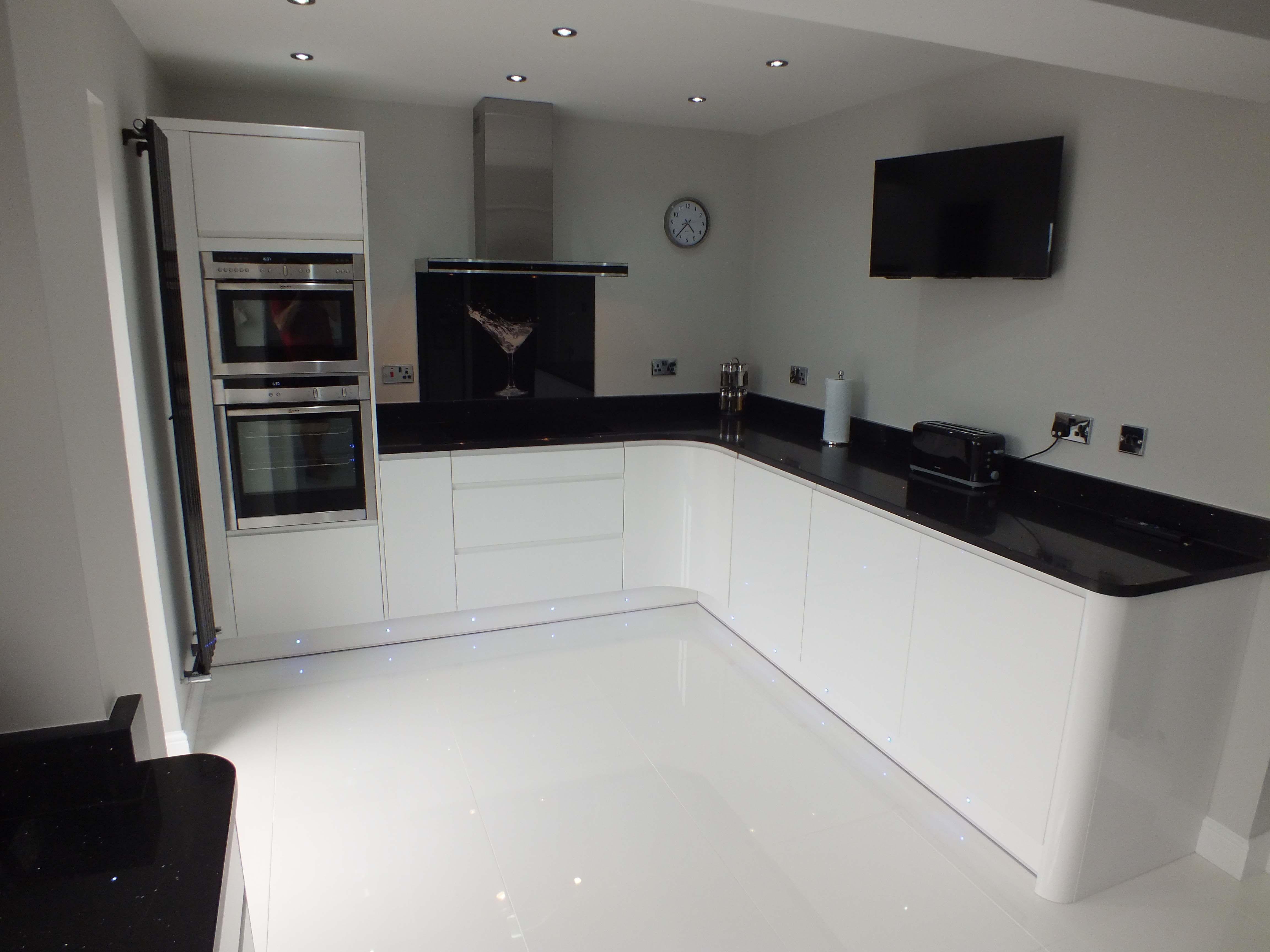 white gloss kitchen white kitchen designs This monochrome kitchen is ultra sleek with Handleless White Gloss units and black worktops The