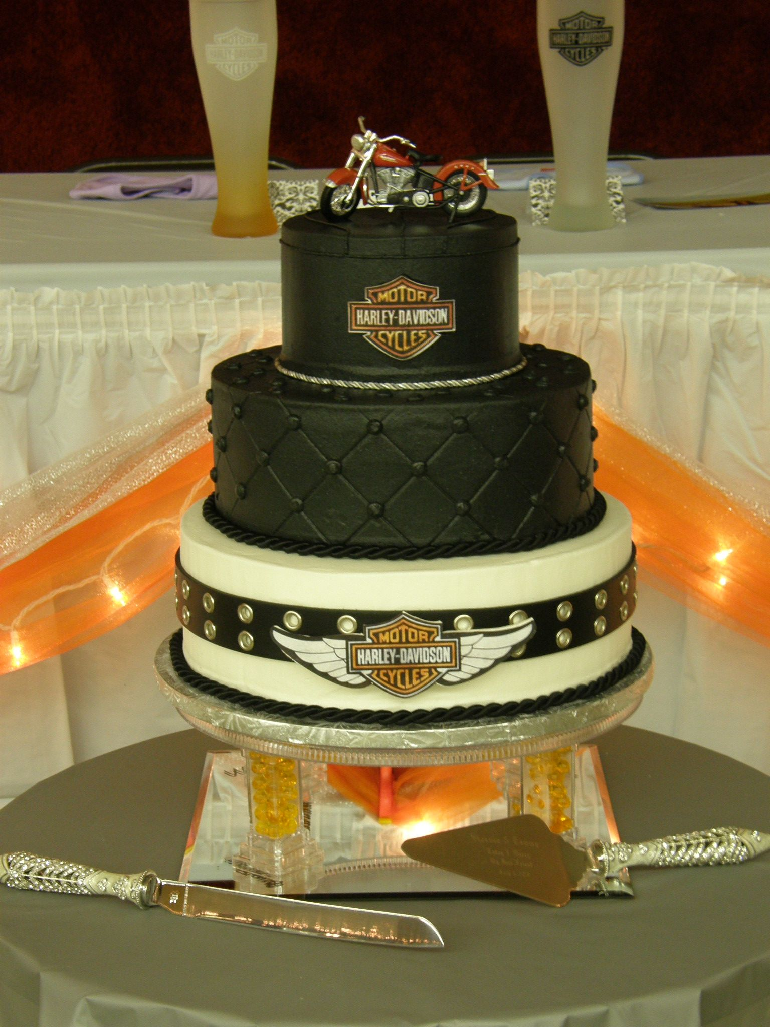 harley davidson wedding bands tiers stacked All buttercream Harley logos are printed from computer and glued to gumpaste cutouts with piping gel Top tier has piping to look like