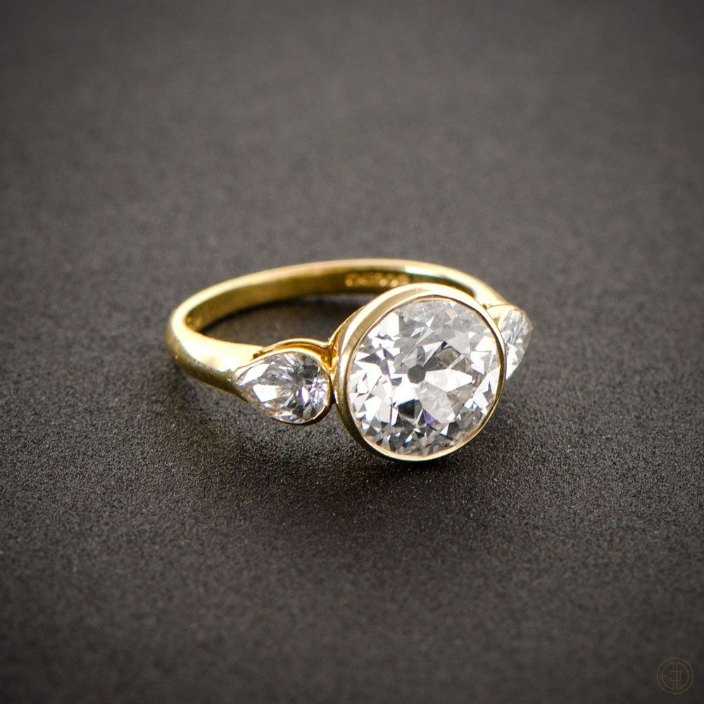 antique wedding ring sets A stunning English Vintage Engagement Ring bezel set in a beautiful yellow gold setting and