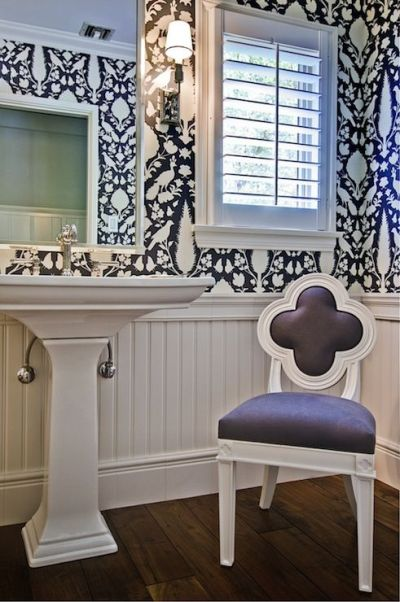Gorgeous powder room with hardwood floors paired with beadboard half wall below Schumacher ...
