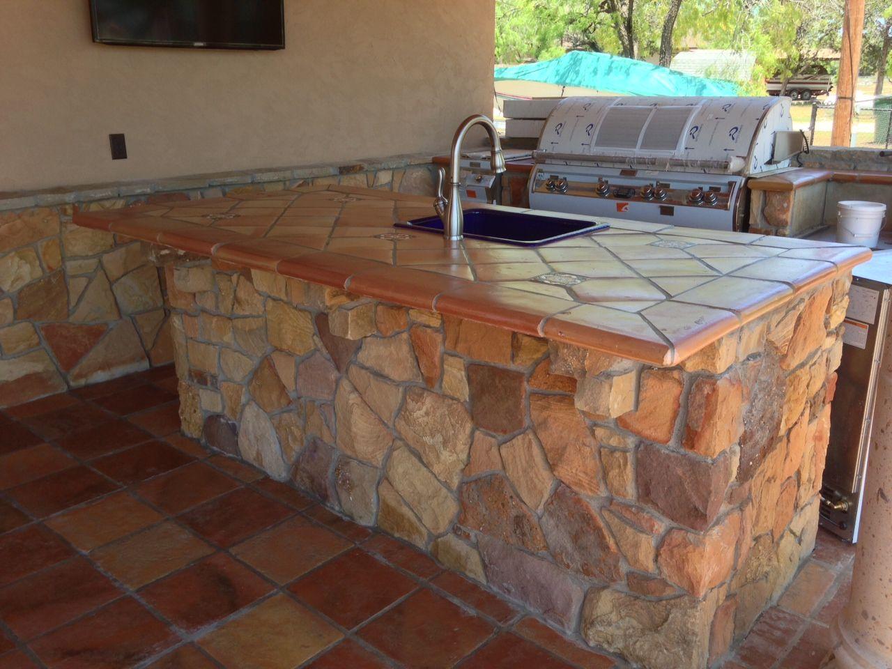 rustic tile floors kitchen countertop tile Antiqued Saltillo Terra Cotta in an outdoor kitchen Rock for wall Saltillo Tile Countertops