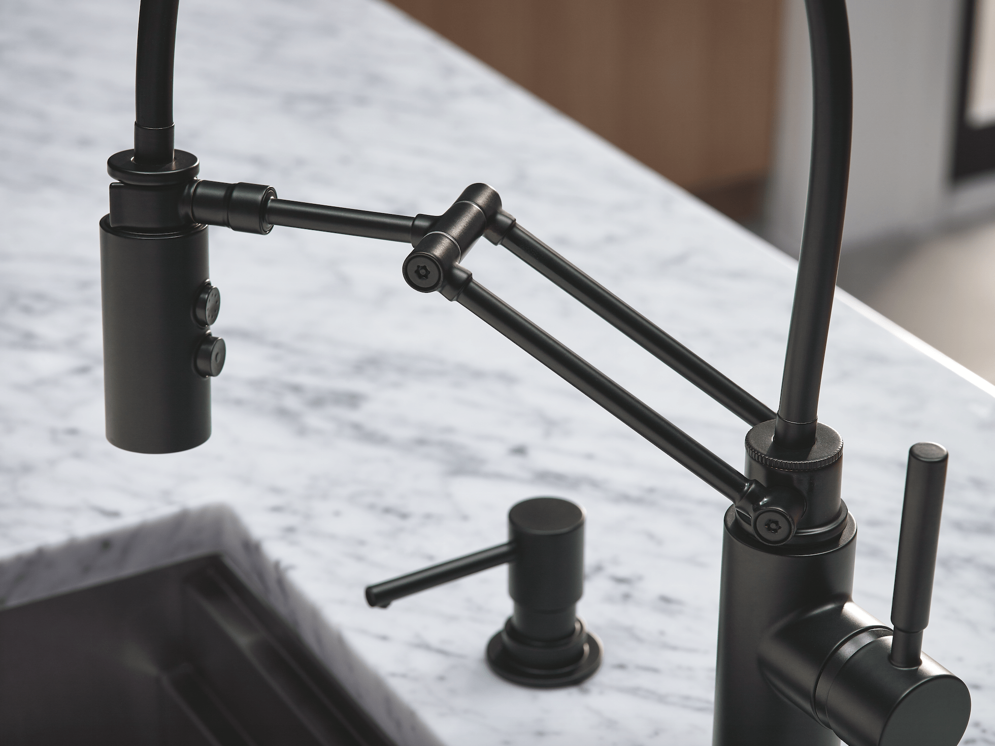 kitchen spaces brizo kitchen faucet The Solna Articulating Kitchen Faucet by Brizo in matte black was the hero in this modern kitchen space designed by