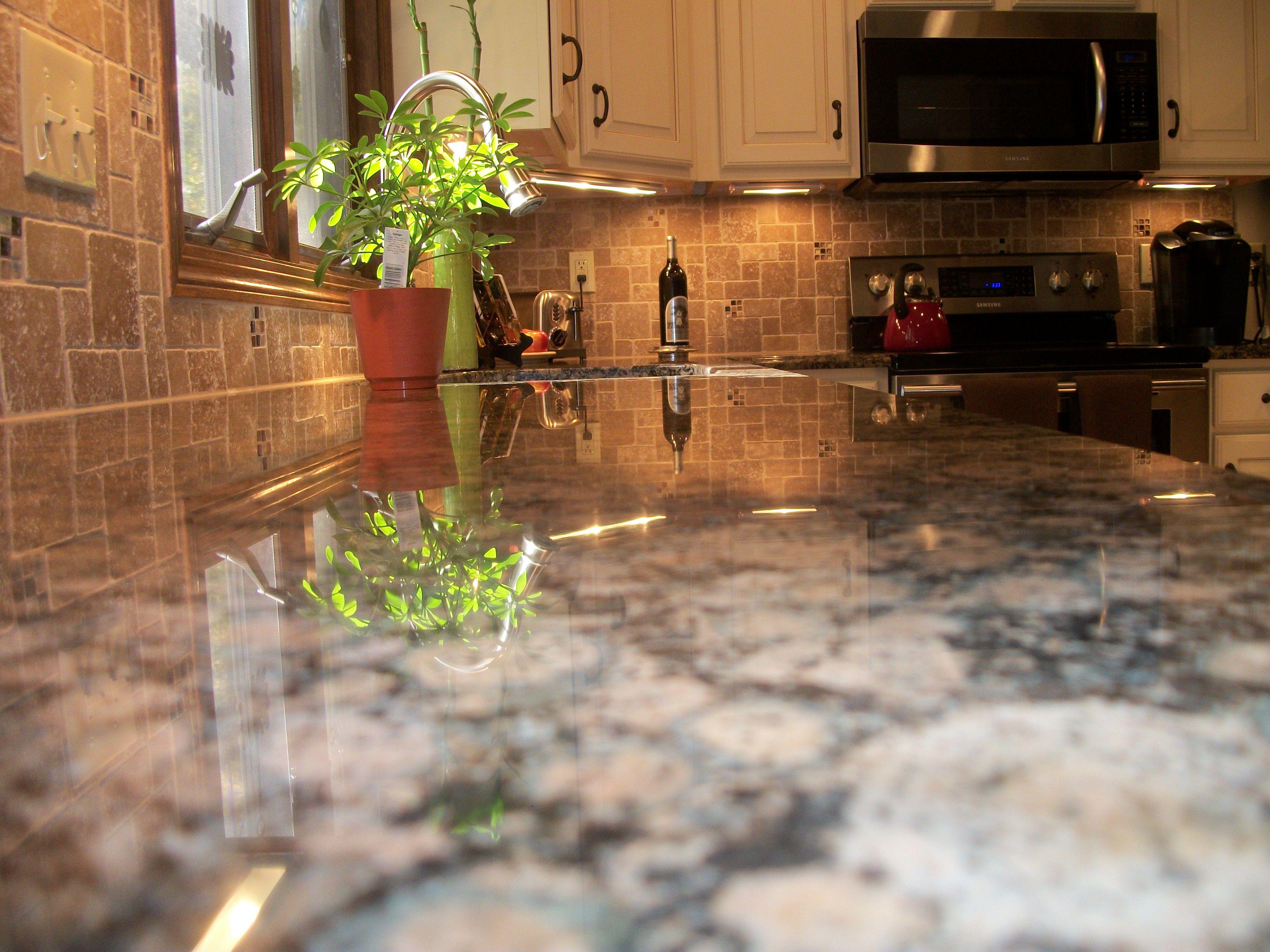 kitchen backsplash backsplash kitchen We installed Baltic Brown Granite countertops and Roman Stone pattern backsplash with glass accents to beautify
