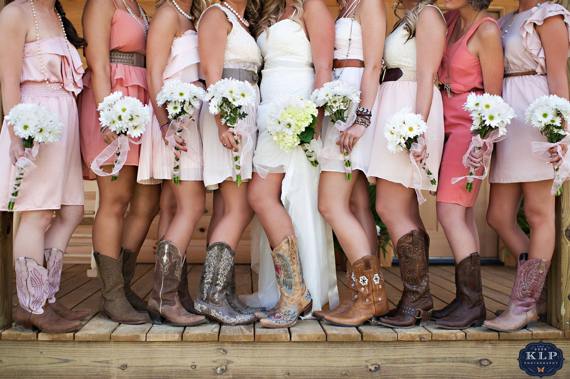 country dresses for weddings These bridesmaids rocked the cowgirl boots and short pink dresses Love the cowgirl boots Country Themed Wedding