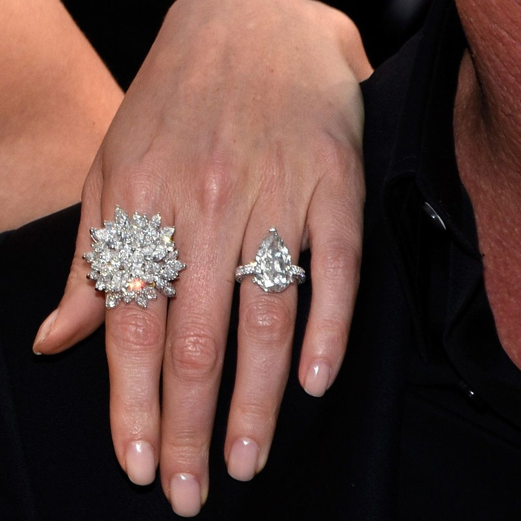 huge wedding ring Charlize Theron Flaunts a Huge Rock on the Red Carpet With Sean Penn Teardrop Engagement RingsCelebrity