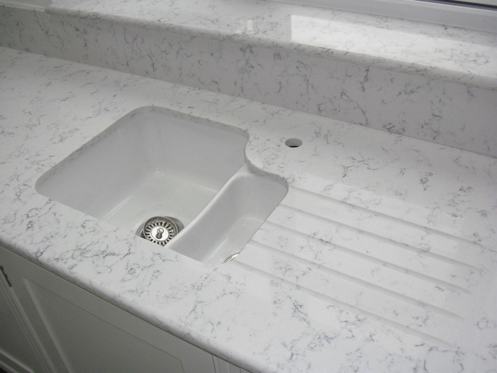 white kitchen sink undermount White ceramic undermount sink with Lyra Silestone worktops drainergrooves undersill and