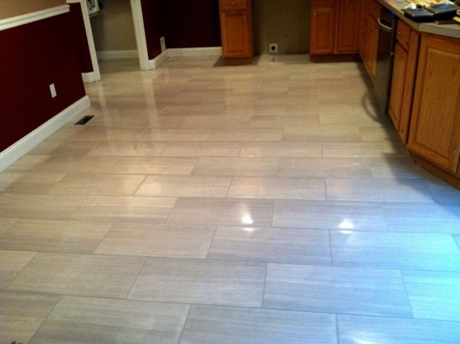 kitchen tiles floor Modern kitchen floor tile by Link Renovations linkrenovations