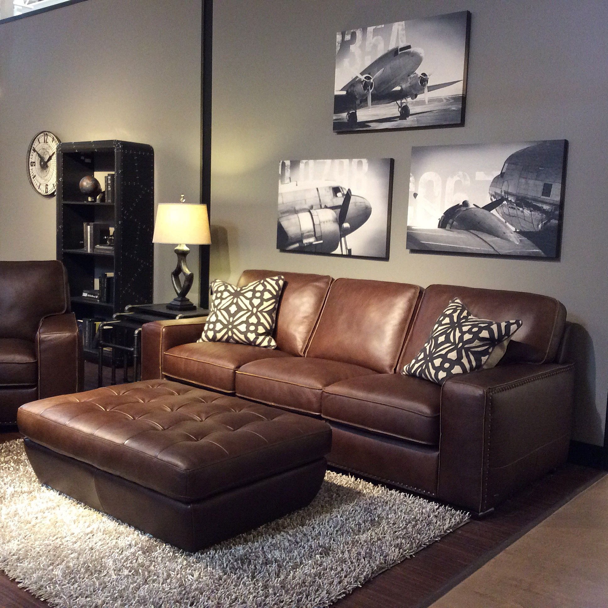 family room with warm gray walls black and white art brown leather furniture grey r