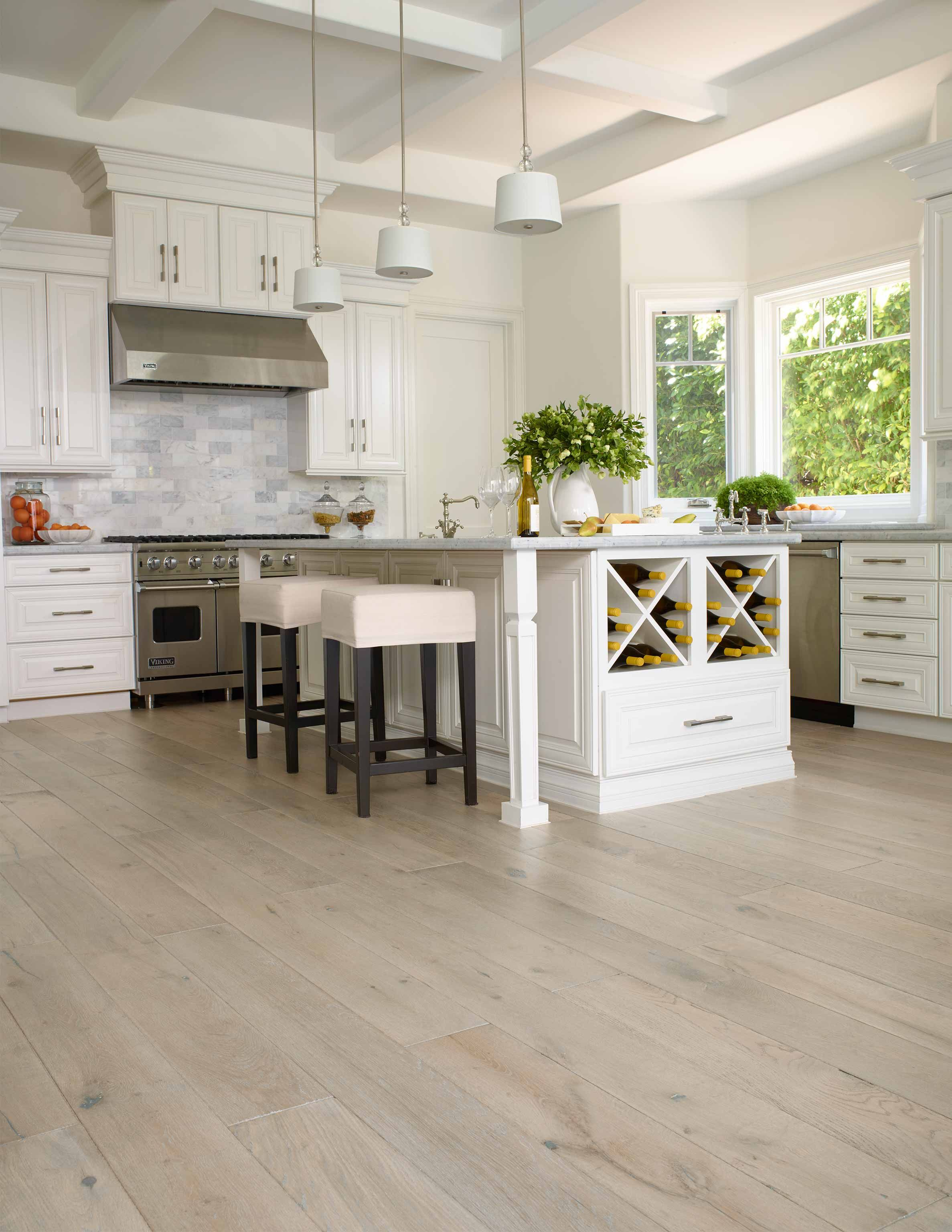 types of kitchen flooring Example of Extra wide plank wood floor by porcelanosa with white kitchen also white slab cabinets with hardware ROSIE BAY Kitchen Pinterest Flats