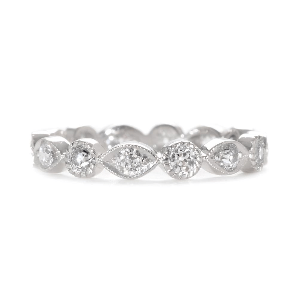 wedding band rings This decorative diamond wedding band features alternating marquis shapes and circles dotted with brilliant pave diamonds